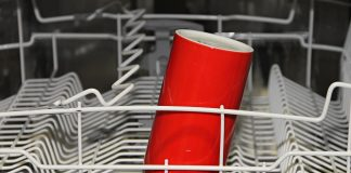 dishwasher and a red cup