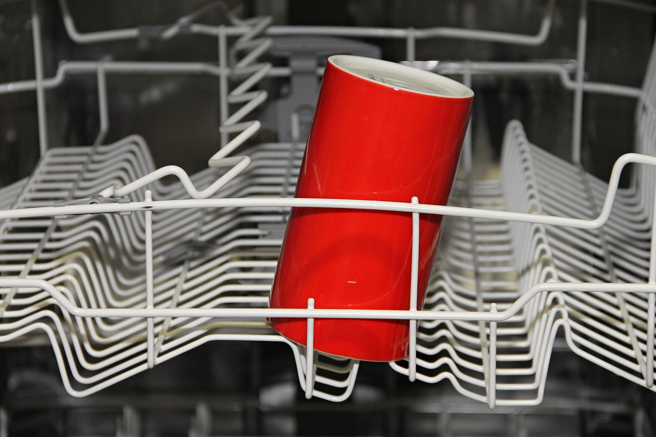 a cup on a dishwasher rack