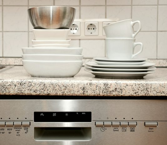 Kitchen Aid kdte254ess dishwasher with table wares on top
