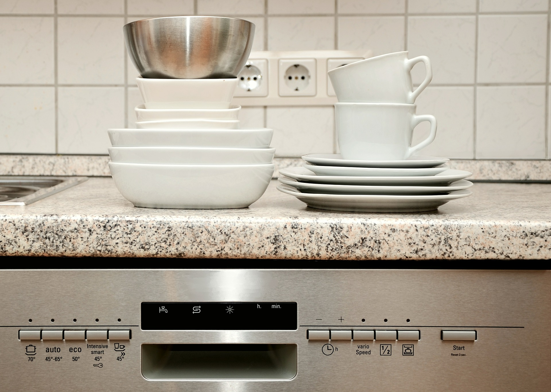 clean plates and mugs washed from whirlpool WDT720PADM dishwasher